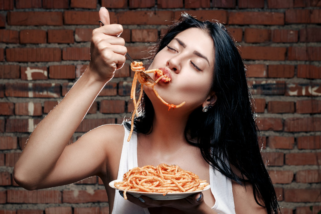 girl eating spaghetti fast