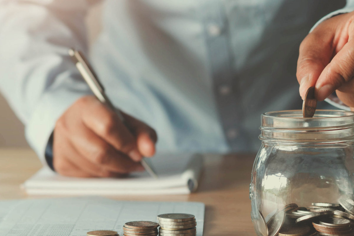 calculating monthly budget and putting savings in jar