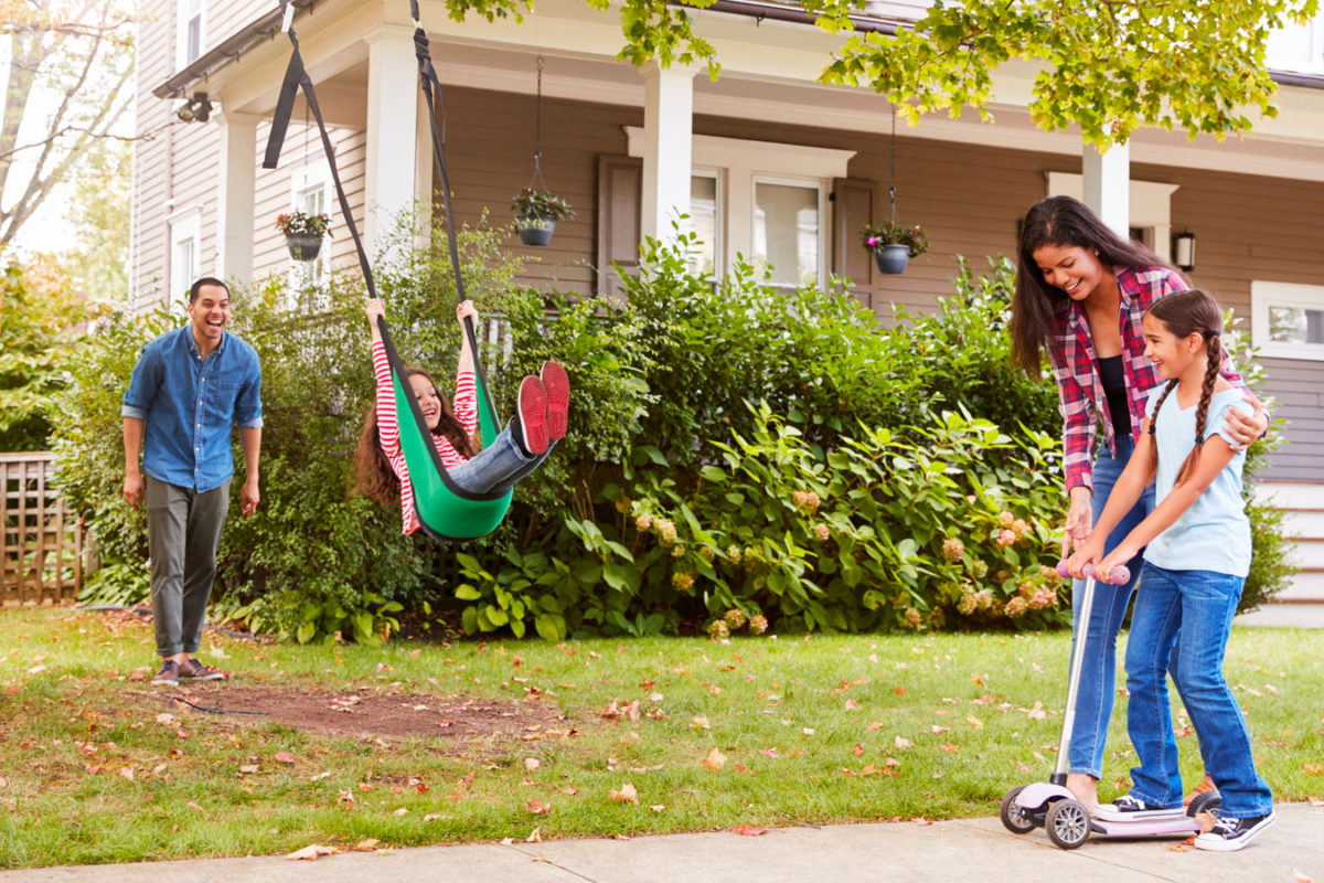 family of four enjoying activities outside to help improve mood