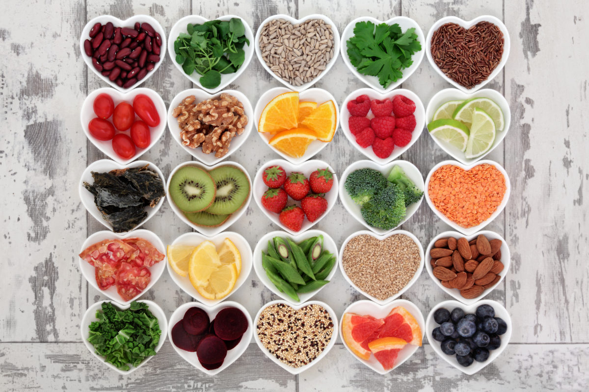 group of heart shaped bowls with heart healthy foods