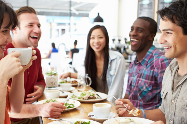 group of friends enjoying conversation around the table building relationships