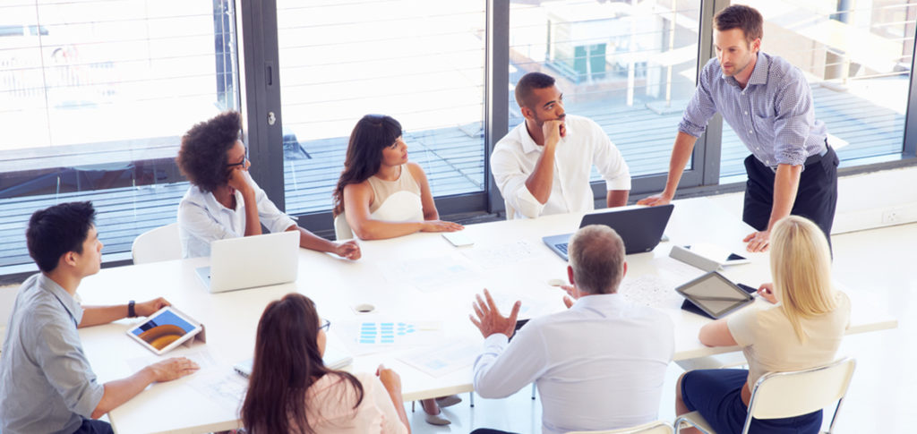 employer talking to a group of new staff for employee onboarding