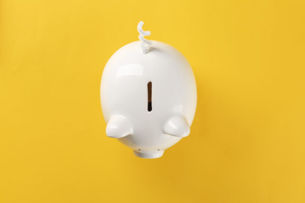 piggy bank on yellow backdrop