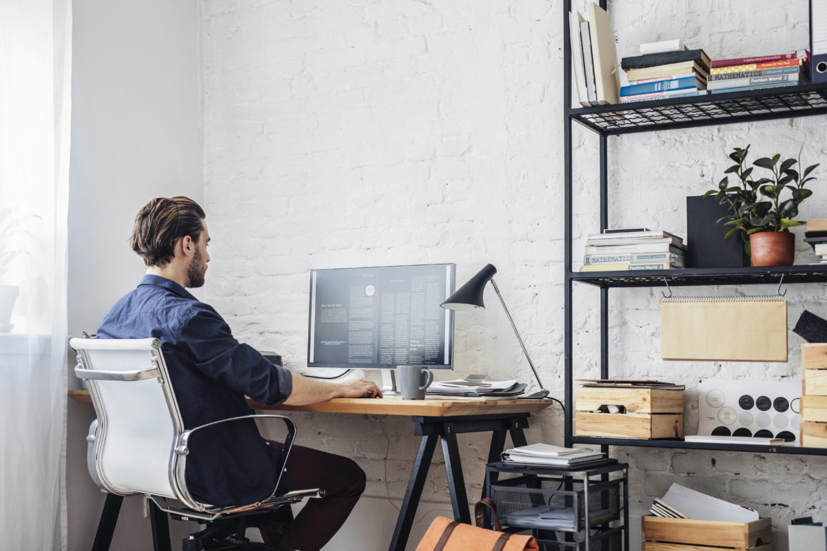 man working from home set up office in corner of the room