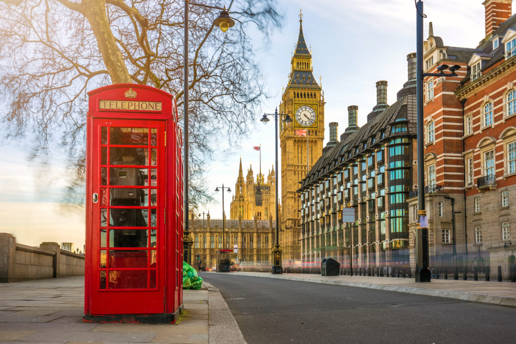 best places to travel internationally - british telephone booth and big ben in london