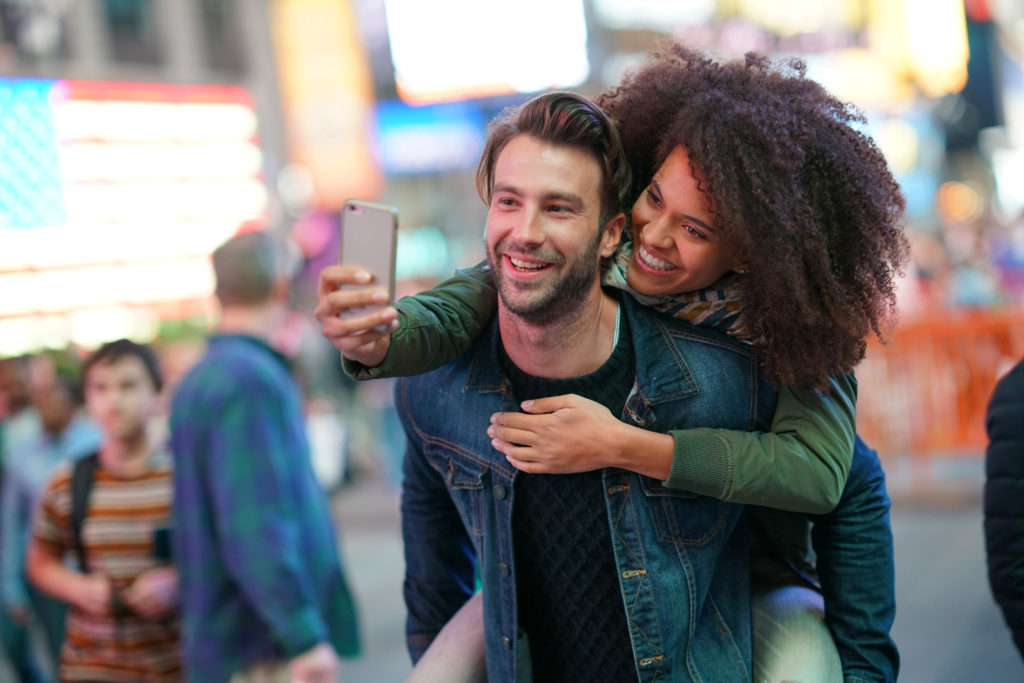 couple taking a selfie in a public plate - date night keeping relationships alive