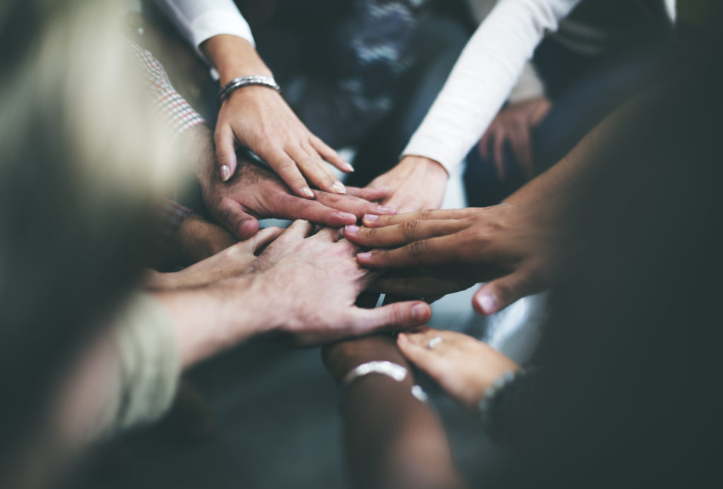 how to be a great leader - team of hands in a circle