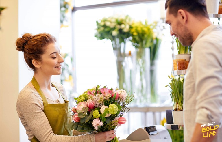 man buying flowers for woman in a flower shop