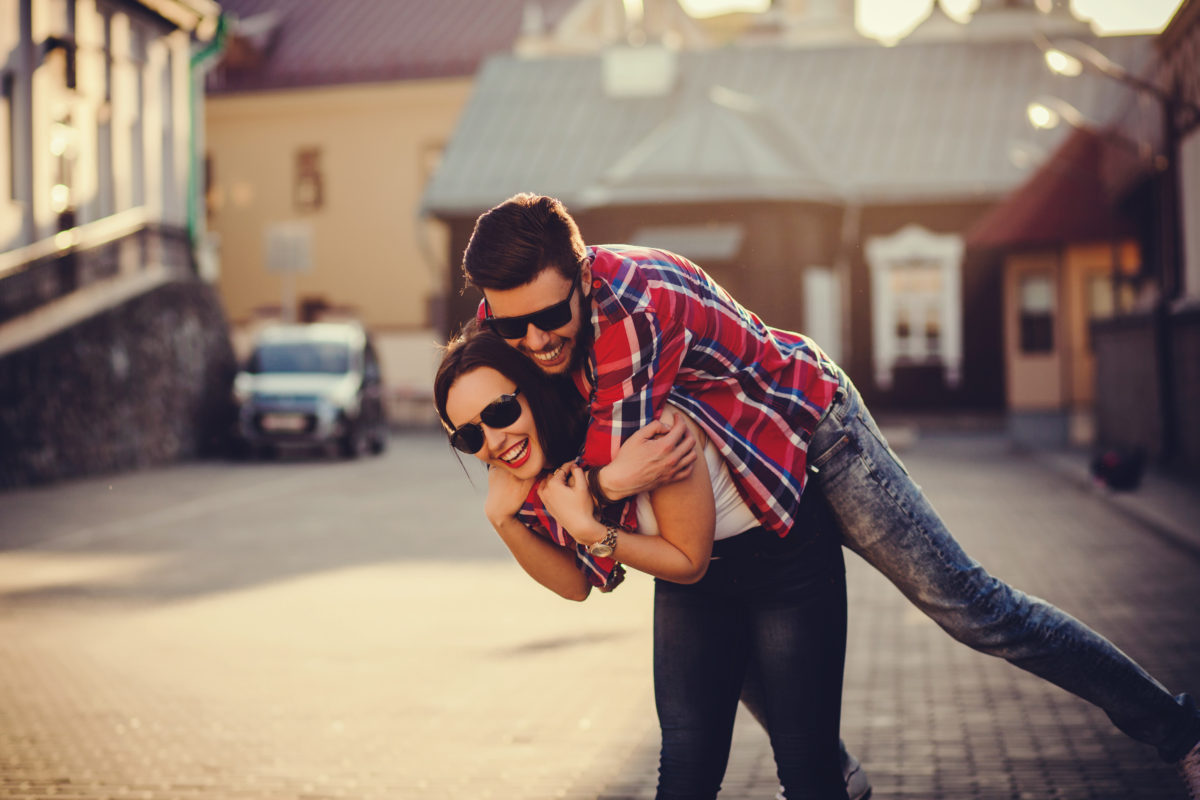woman giving man a piggy back ride - signs you're ready for a committed relationship