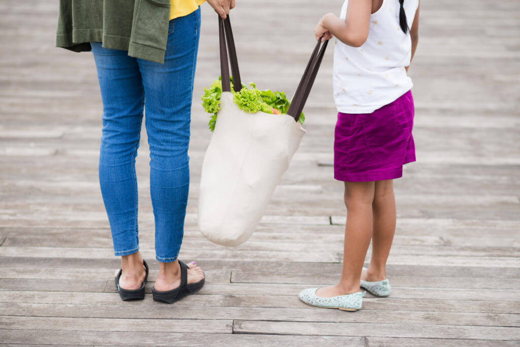 bring reusable bags when shopping at the grocery store to reduce carbon footprint