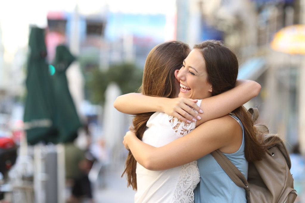 two girl friends hugging, overcoming a toxic relationship