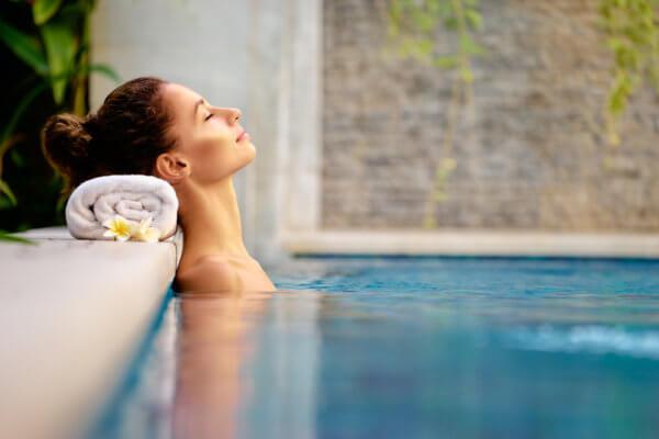 woman relaxing in pool enjoying her spa destination