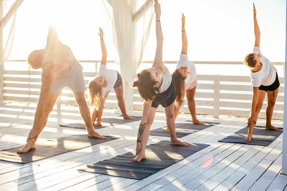group yoga class outside at a spa destination