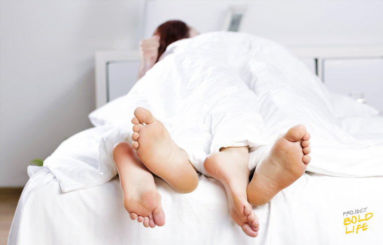 feet in bed under covers - how men and women view sex