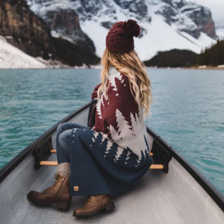 girl wearing tentree in a canoe
