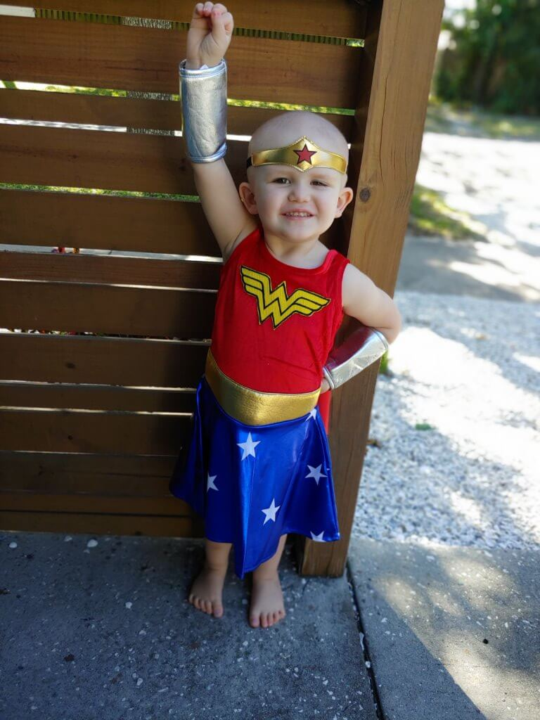 Trinity posing as a real-life wonder woman inspired people to give to a local toy drive