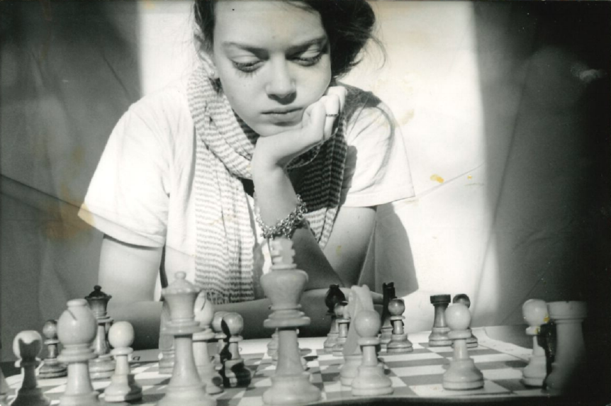 Nicole Maffeo playing chess as a young girl