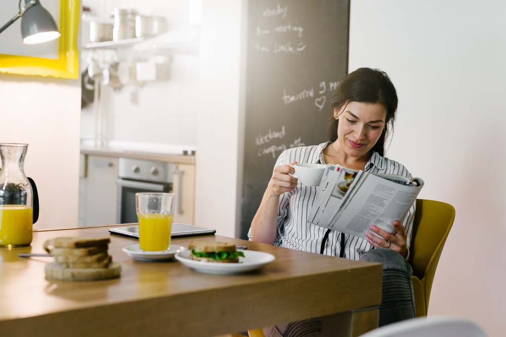 woman enjoying her morning routine with coffee to start day right and increase productivity