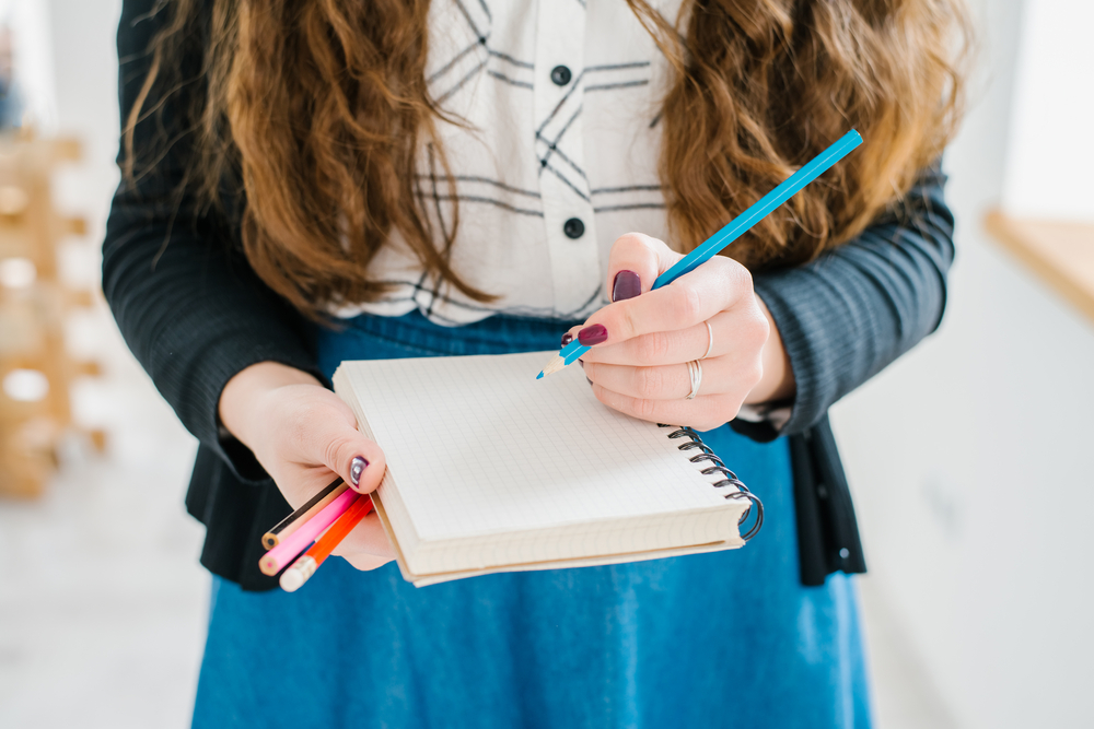girl working on her to-do list in order to increase productivity