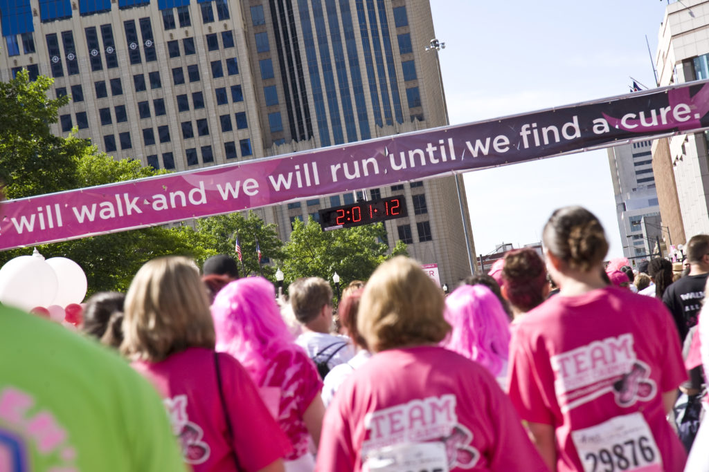 group of women walking to find a cure for cancer