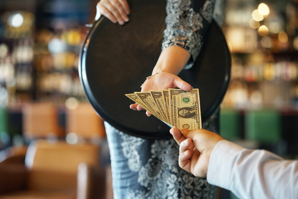 man skimping on tip to waitress - difference between being frugal and cheap