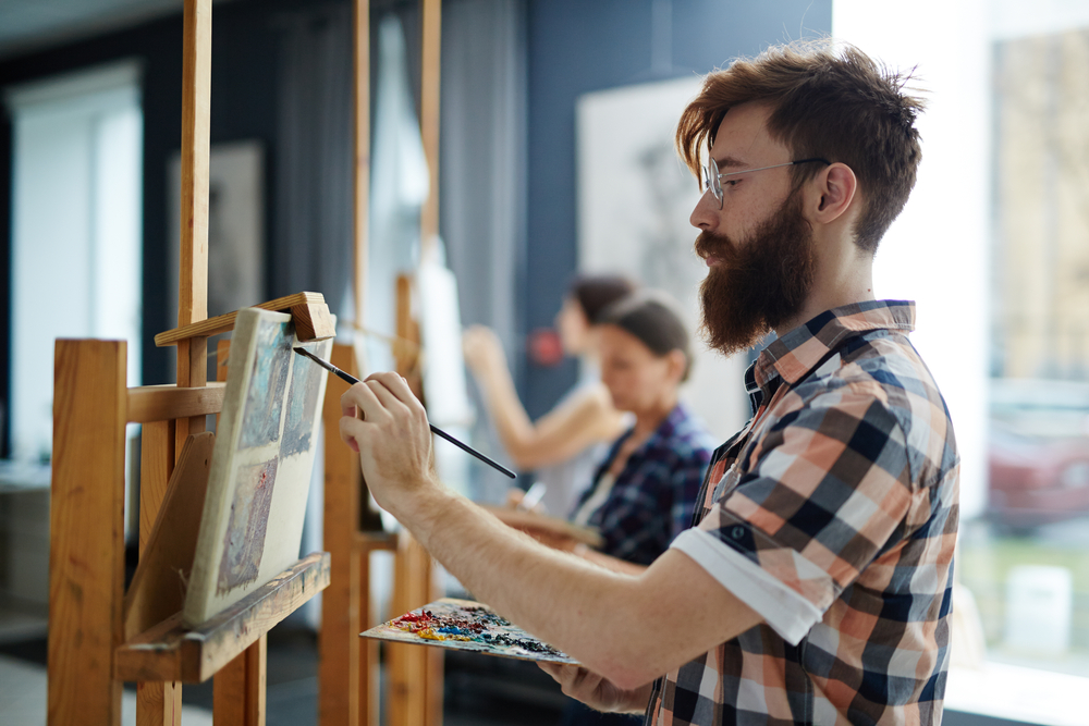 group of artists painting as a creative fundraising idea