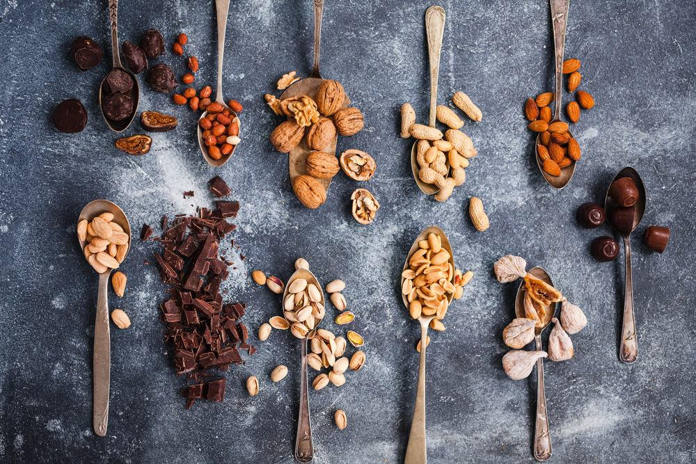 spoons full of chocolate and nuts - foods that cause migraines