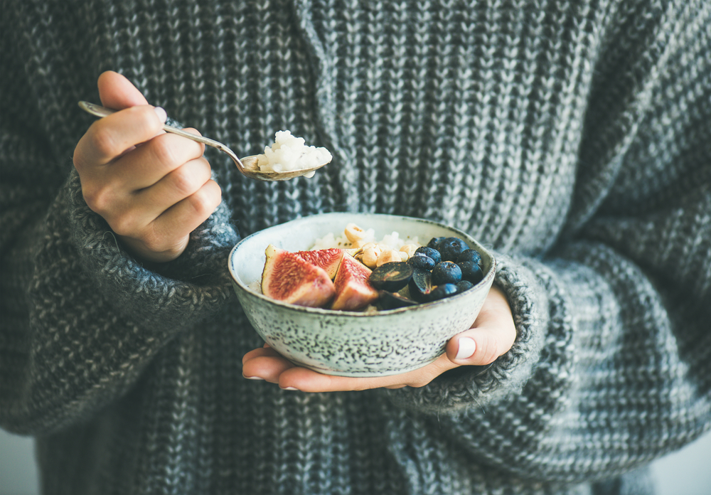 woman holding a bowl of real food for detox diet