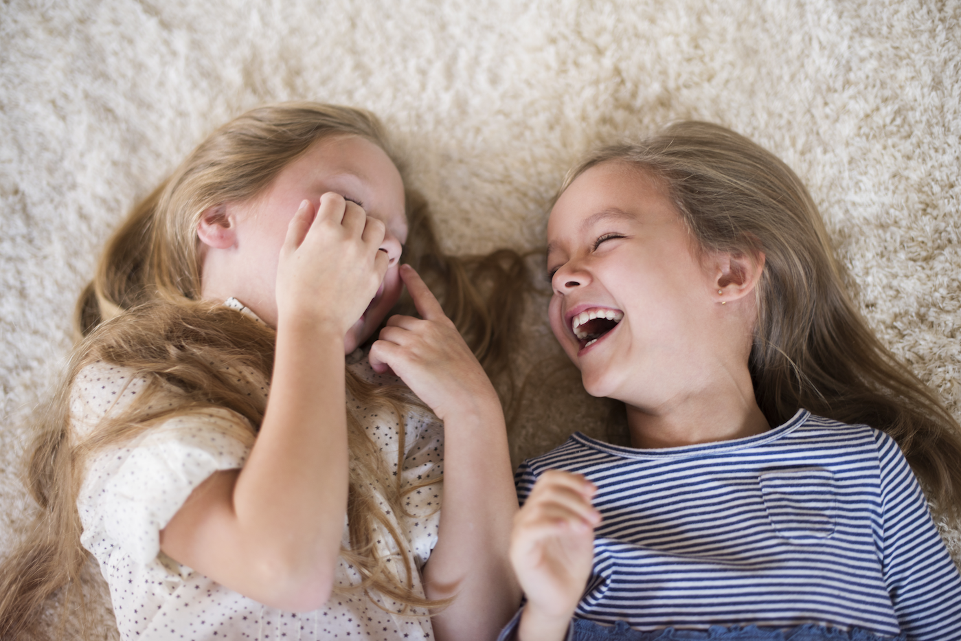 Two young girls laughing