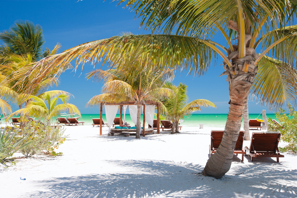 beach beds on the white sands of holbox island in mexico - best beaches beyond cancun