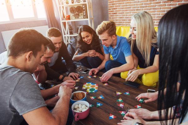 group of adults playing fun board games