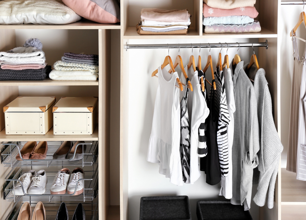 a beautifully organized closet with minimal clothing - how to declutter your life