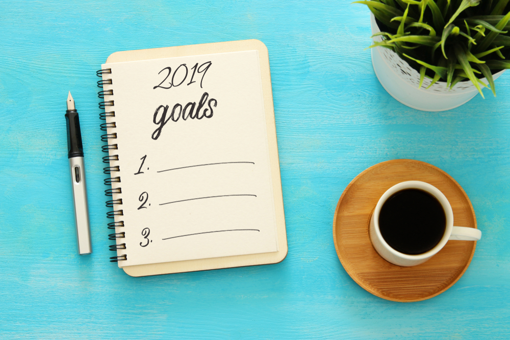 table with goals journal to help you keep your new year's resolution
