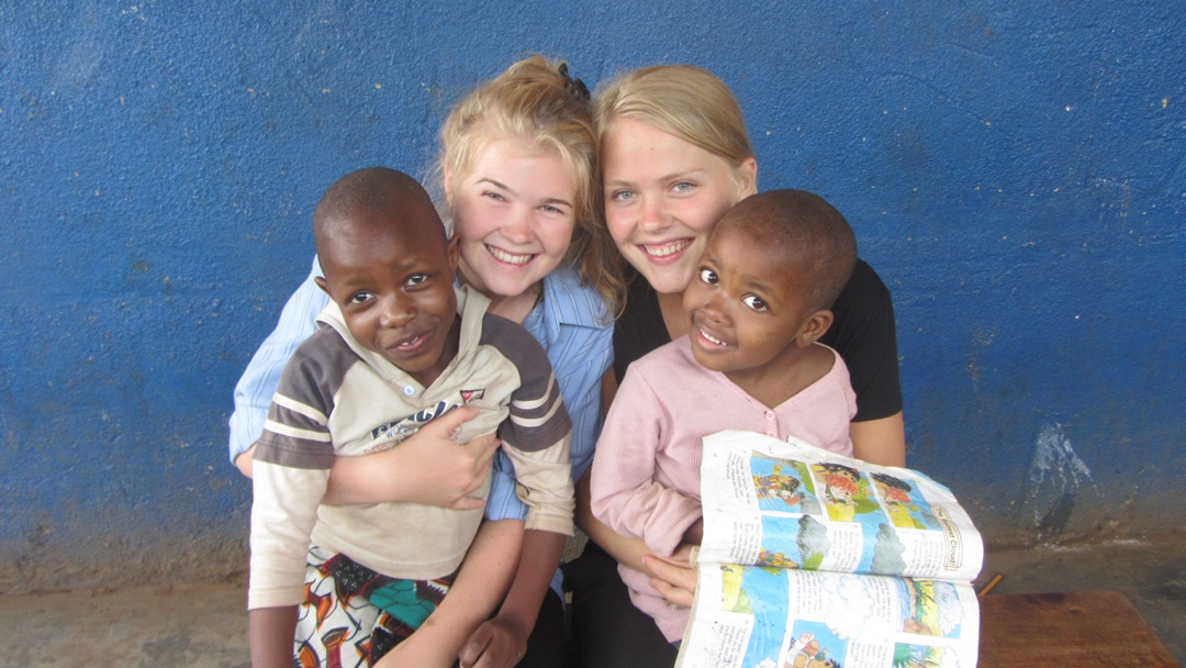 A pair of girls volunteering with volunteering solutions organization in tanzania