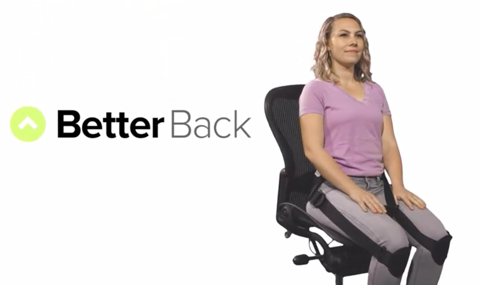better back posture corrector shown on a woman sitting in a chair