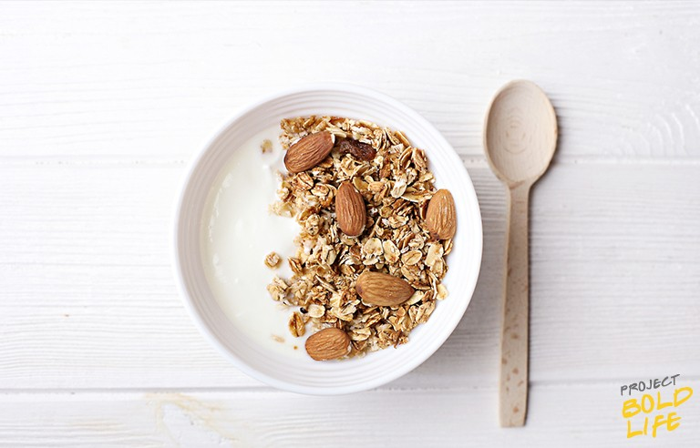 bowl of greek yogurt, almonds and oats - all good foods to eat before bed