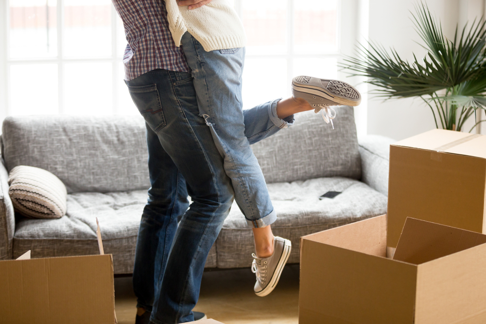 young millennial couple celebrating their new homeownership