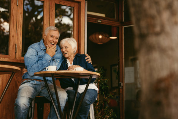 retired couple enjoying coffee at a cafe