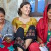 3 women volunteering while traveling