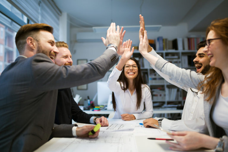 Group of coworkers staying motivated together
