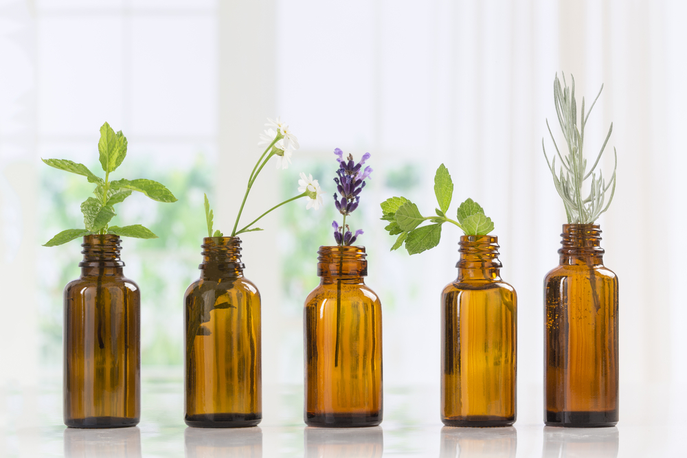 different types of essential oils in bottles