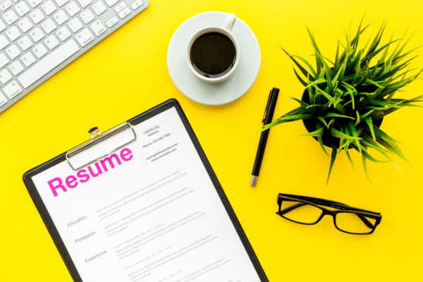 resume on a bright yellow desk - how to get your resume noticed