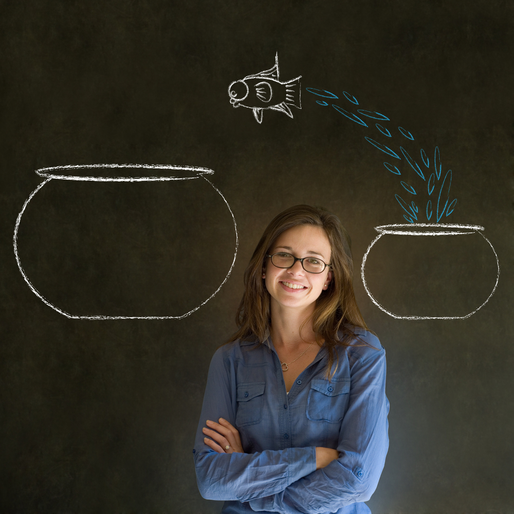 girl in front of a picture of a fish jumping from a small bowl to a big bowl - reinventing yourself