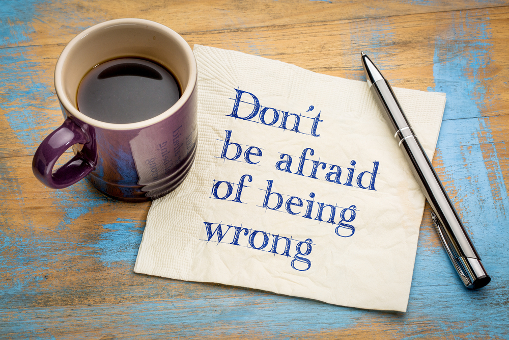 a coffee cup and note about being wrong