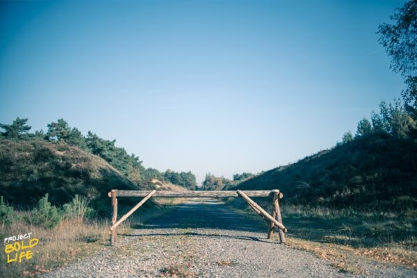 roadblock on a dirt road in the countryside symbolizing overcoming roadblocks in your career