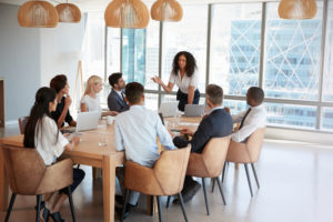woman leading a productive meeting and presentation