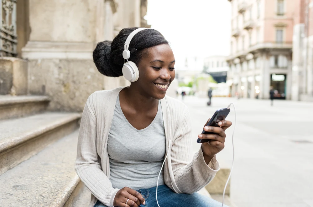 woman listening to classical music pieces on her iphone