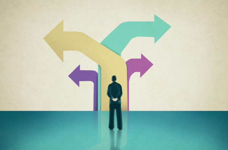 illustration of professional contemplating career change after 40 with arrows pointing in different directions