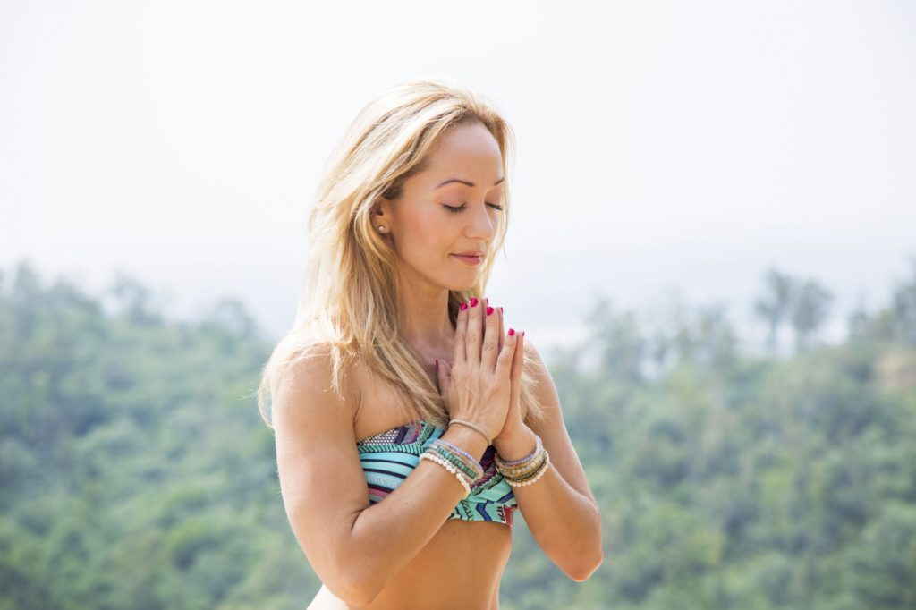 yoga guru kino macgregor practicing yoga