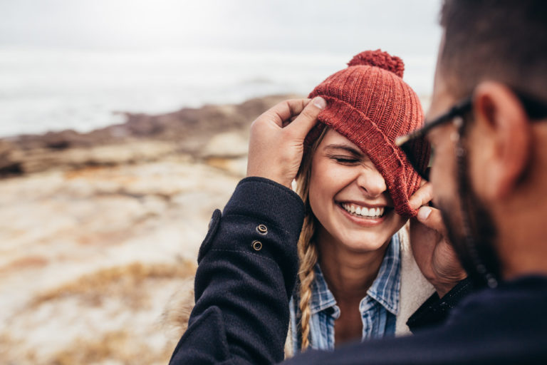 a woman smiling with boyfriend being authenic